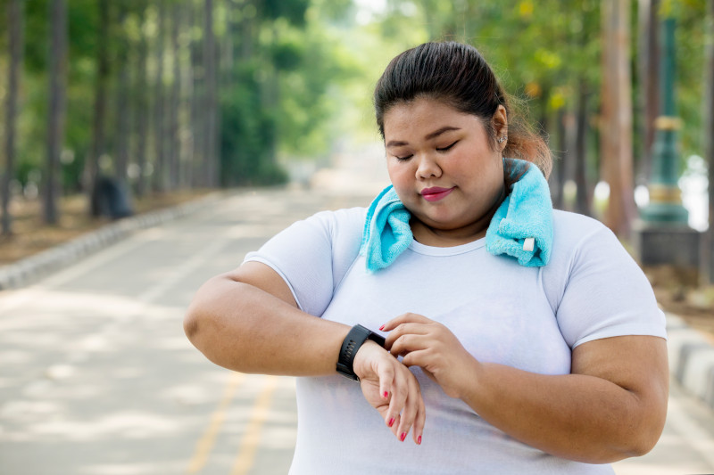 Overweight woman wearing her smartwatch