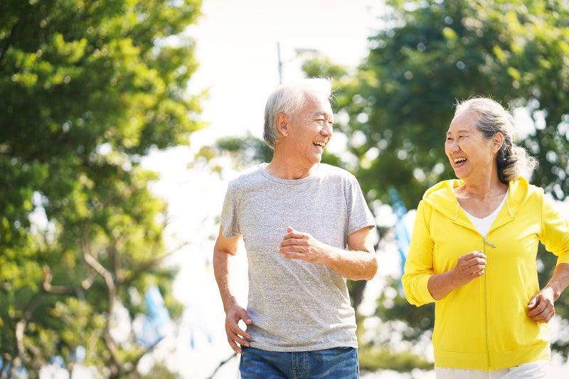 Couple speed walking outside