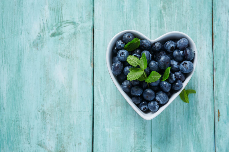 blueberries in heart shaped dish