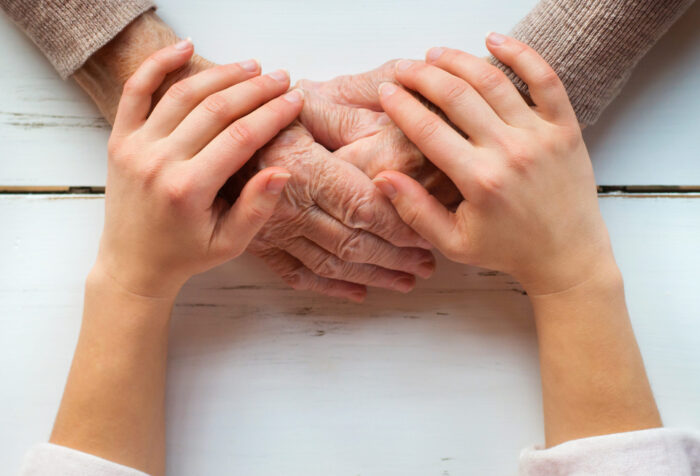 younger and older generation hands