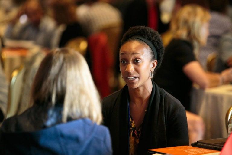 AFMCP participants in conversation