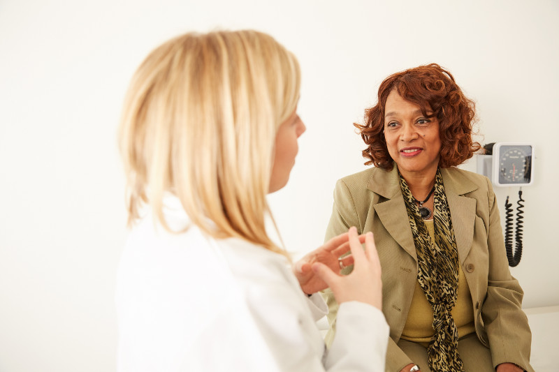 Doctor talking to patient about reversing immune dysfunction