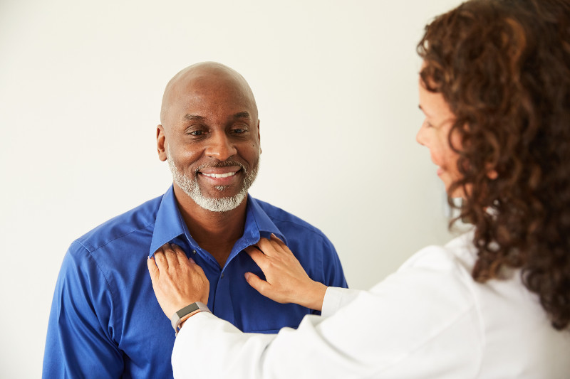 Independent Primary Care Physician doing a breathing test on patient