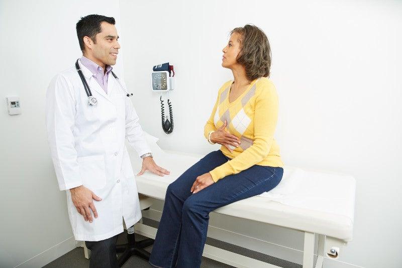 Functional Medicine doctor examining patient.