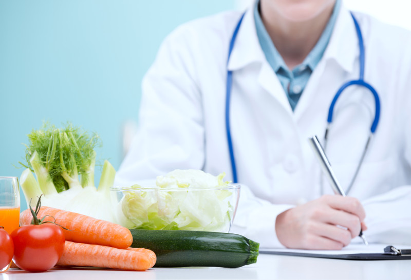 Doctor prescribing diet interventions for SIBO